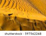 golden sands of sahara. texture ... | Shutterstock . vector #597562268