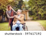 senior man in wheelchair with... | Shutterstock . vector #597617192