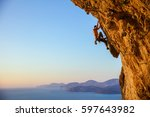 young man struggling to climb... | Shutterstock . vector #597643982