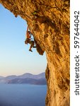 rock climber on challenging... | Shutterstock . vector #597644042