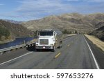 semi truck driving on mountain... | Shutterstock . vector #597653276