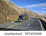 Semi Truck Driving On Mountain...