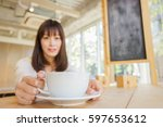 young woman relaxing at cafe | Shutterstock . vector #597653612