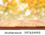 empty wood table with bokeh... | Shutterstock . vector #597654995
