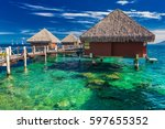 overwater bungalows with best... | Shutterstock . vector #597655352