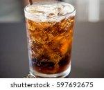 sparkling cola water | Shutterstock . vector #597692675