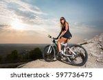 female biker athlete in the...   Shutterstock . vector #597736475