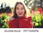 dreamy young hipster girl... | Shutterstock . vector #597764096