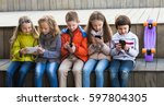 smiling kids sitting with... | Shutterstock . vector #597804305