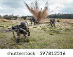 Small photo of Squad of elite french paratroopers of 1st Marine Infantry Parachute Regiment RPIMA ambushed in action, landmine exploding