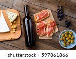 cheese  wine  meat and fruits.... | Shutterstock . vector #597861866