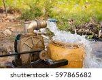 water flow from motor water pump | Shutterstock . vector #597865682