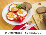 fried eggs in red peppers....   Shutterstock . vector #597866732