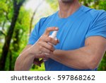 mosquito repellent. man using... | Shutterstock . vector #597868262