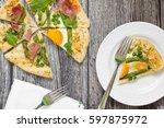 spring vegetable galette  top...   Shutterstock . vector #597875972