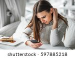 girl texting on the smart phone ... | Shutterstock . vector #597885218
