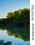 Small photo of Small lake with a wooden cabin, Ada cable bridge in a background, Belgrade, Serbia