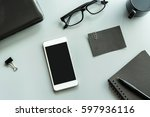 blank notebook with cellphone... | Shutterstock . vector #597936116
