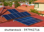 solar panels on a red roof in a ...