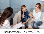 on style. attractive mother... | Shutterstock . vector #597960176
