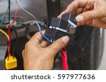 installation of electrical... | Shutterstock . vector #597977636