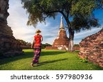 tourist woman in red costume... | Shutterstock . vector #597980936