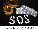 white pills on black background ... | Shutterstock . vector #597993806