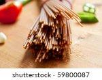 brown spelt spaghetti with... | Shutterstock . vector #59800087
