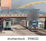 Smoky freight train - stock photo