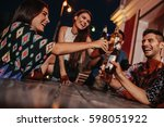 group of friends toasting... | Shutterstock . vector #598051922