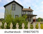 Old House With A White Picket...
