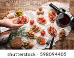 tasty bruschetta served with... | Shutterstock . vector #598094405