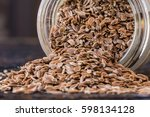 dill seeds spilled from spice... | Shutterstock . vector #598134128