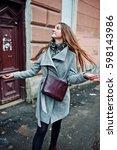 young model girl in a gray coat ... | Shutterstock . vector #598143986