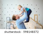dad throws up her little boy... | Shutterstock . vector #598148372