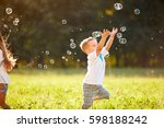 cute male child catches soap... | Shutterstock . vector #598188242