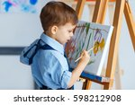 cute  serious and focused ... | Shutterstock . vector #598212908
