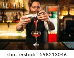 barman is making alcohol... | Shutterstock . vector #598213046