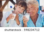 grandmother with granddaughter... | Shutterstock . vector #598234712