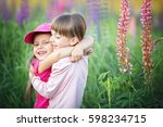 cute little girls huggings...   Shutterstock . vector #598234715