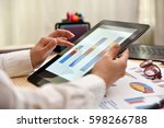 hand of trader woman touching... | Shutterstock . vector #598266788