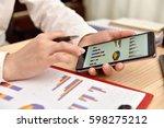 businesswoman analyzing chart... | Shutterstock . vector #598275212