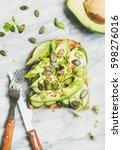 healthy green veggie breakfast... | Shutterstock . vector #598276016