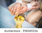 close up groom and bride hand...   Shutterstock . vector #598285526