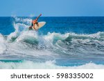 riding the waves. costa rica ... | Shutterstock . vector #598335002
