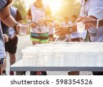 runner take a water in a... | Shutterstock . vector #598354526