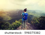 successful woman hiker taking... | Shutterstock . vector #598375382