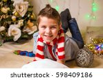 the boy in the striped scarf at ... | Shutterstock . vector #598409186