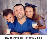 father with children are... | Shutterstock . vector #598418555