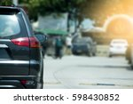 cars on the road heading... | Shutterstock . vector #598430852